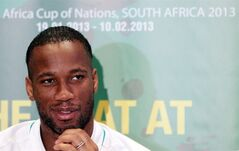 Ivory Coast's soccer captain Didier Drogba looks on before addressing journalists as the team arrived for the African Cup of Nations at Lanseria airport in Johannesburg, South Africa, Wednesday Jan. 16, 2013. (AP Photo/Themba Hadebe)