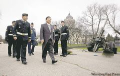 Lt.-Gov. Philip Lee meets with soldiers as he prepares to head into the legislature Tuesday to read the throne speech.