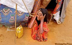 Though she has reached relative safety, a woman in the Dadaab camp still shows the ravages of famine.
