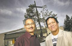 Alan Agpalza (left), a member of the parish pastoral council, with Msgr. Enrique Samson Jr., the church's pastor, at St. Peter's Roman Catholic Church.