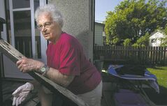 Emily Stirling, 84, didn't know her Ross Avenue home once housed labour leader R.B. Russell, but she sees hard times coming for workers once again.