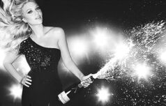 Hollywood actress Scarlett Johansson pops a champagne cork.