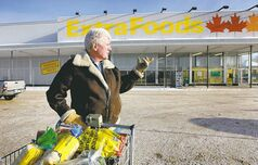 Paul Cogill finishes his shopping at the Main Street Extra Foods store, which is being closed in March. Another store in Steinbach is also closing.