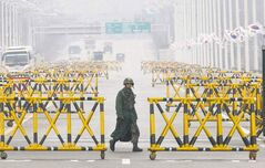 A South Korean army soldier walks near the border village of Panmunjom Saturday.