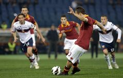 AS Roma forward Francesco Totti scores on a penalty kick during a Serie A soccer match between As Roma and Genoa, in Rome's Olympic stadium, Sunday, March 3, 2013. (AP Photo/Andrew Medichini)