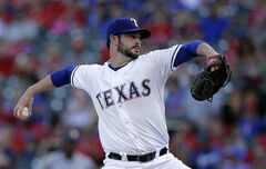 Texas Rangers starting pitcher Phil Irwin works against the Houston Astros in the first inning of a baseball game, Tuesday, July 8, 2014, in Arlington, Texas. (AP Photo/Tony Gutierrez)
