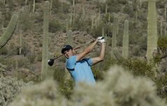 Martin Kaymer watches his tee shot on the 17th hole during a practice round at the Match Play Championship golf tournament on Tuesday, Feb. 18, 2014 in Marana, Ariz. (AP Photo/Chris Carlson)