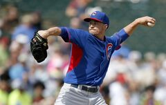 Chicago Cubs' Chris Rusin throws a pitch in the first inning during a spring training baseball game against the Los Angeles Angels, Friday, Feb. 28, 2014, in Tempe, Ariz. The Angels won 15-3. (AP Photo/Ross D. Franklin)