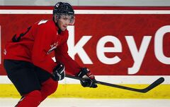 Boone Jenner, from Dorchester, Ont., skates during the National Junior hockey team selection camp in Calgary, Alta., Tuesday, Dec. 11, 2012. Jenner, was assessed a five-minute major and a game misconduct for charging after a late hit on Sweden's Jesper Pettersson in the second period during his team's final warmup game in Finland on Saturday Dec. 22, 2012. THE CANADIAN PRESS/Jeff McIntosh