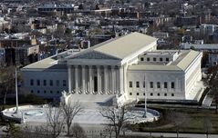 A view of the U.S. Supreme Court is picture from near the top of the Capitol Dome in Washington, on Dec. 19, 2013. THE CANADIAN PRESS/AP, Susan Walsh