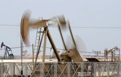 Oil pumps work in the desert oil fields of Sakhir, Bahrain, Nov. 29, 2012. THE CANADIAN PRESS/AP, Hasan Jamali
