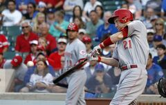 Cincinnati Reds' Todd Frazier hits an RBI triple off Chicago Cubs starting pitcher Jeff Samardzija, scoring Billy Hamilton, during the first inning of a baseball game Monday, June 23, 2014, in Chicago. (AP Photo/Charles Rex Arbogast)