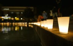 Candles line a wall around a reflection pond at the University of Central Florida, Wednesday, Sept. 3, 2014, in Orlando, Fla., to honor Steven Sotloff, the second American journalist to be beheaded by the Islamic State militant group in two weeks. Sotloff attended the University of Central Florida between 2002 and 2004. (AP Photo/John Raoux)