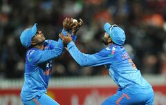 India's Ambati Rayudu, left, and Ravindra Jadeja clash as they drop a catch off the bat of New Zealand's Brendon McCullum in the fourth one day International cricket match at Seddon Park in Auckland, New Zealand, Tuesday, Jan. 28, 2014. (AP Photo/SNPA, Ross Setford) NEW ZEALAND OUT