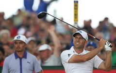 Sergio Garcia of Spain watches his 16th tee shot as Rickie Fowler of the US looks along the fairway during the third day of the British Open Golf championship at the Royal Liverpool golf club, Hoylake, England, Saturday July 19, 2014. (AP Photo/Scott Heppell)