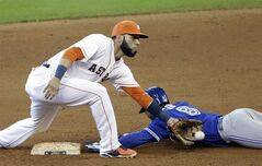 Toronto Blue Jays' Anthony Gose (8) steals second base as Houston Astros shortstop Marwin Gonzalez reaches for the ball in the fifth inning of a baseball game, Sunday, Aug. 3, 2014, in Houston. (AP Photo/Pat Sullivan)
