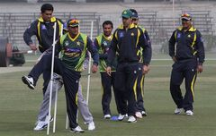 Captain of Pakistan's T20 cricket team Mohammad Hafeez, front, and teammates attend a practice session at Gaddafi Stadium in Lahore, Pakistan, Wednesday, Feb. 19, 2014. Hafeez says Pakistan will miss tall fast bowler Mohammad Irfan in the World Twenty20 after paceman could not recover from a hip injury. Pakistan will be defending the Asia Cup title it won in 2012 by defeating Bangladesh in the final by two runs, but Hafeez said there's no favorite when the tournament starts on Feb. 25. (AP Photo/K.M. Chaudary)