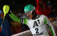 Felix Neureuther of Germany celebrates in the finish area after winning an alpine ski, men's World Cup slalom, in Kitzbuehel, Austria, Friday, Jan. 24, 2014. (AP Photo/Giovanni Auletta)