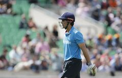 England's captain Alastair Cook walks off the field of play after losing his wicket off the bowling of Sri Lanka's Nuwan Kulasekara during the One Day cricket match between England and Sri Lanka at the Oval cricket ground in London, Thursday, May 22, 2014. (AP Photo/Matt Dunham)