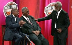 Former University of Arkansas head coach Nolan Richardson, right, jokes with Hall of Fame player Tiny Archibald, left, and coach John Thompson at a gathering during his enshrinement ceremony for the Basketball Hall of Fame in Springfield, Mass., Friday, Aug. 8, 2014. Richardson led Arkansas to the 1994 National Championship and to three Final Four appearances in 1990. 1994 and 1995. (AP Photo/Charles Krupa)