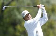 Kiyoshi Murota, of Japan, hits his tee shot on the fourth hole during the third round of the 75th Senior PGA Championship golf tournament at Harbor Shores Golf Club in Benton Harbor, Mich., Saturday, May 24, 2014. (AP Photo/Paul Sancya)
