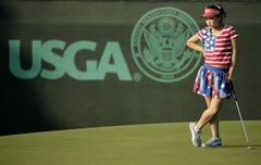Lucy Li waits to putt on the 13th green during the first round of the U.S. Women's Open golf tournament in Pinehurst, N.C., Thursday, June 19, 2014. (AP Photo/Chuck Burton)