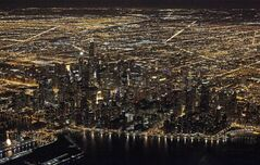 FILE - This Sunday, Nov. 24, 2013, file photo, shows an aerial view at night of the downtown Chicago skyline. Star Wars