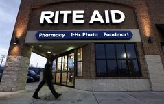 FILE - In this Dec. 15, 2009 file photo, a customer enters a Rite Aid store in Detroit. Rite Aid reports quarterly financial results on Thursday, June 19, 2014. (AP Photo/Paul Sancya, File)