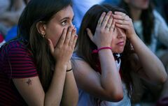 Allison DiFilippo, left, and Samantha Donat, both of New York, react to a last-minute goal that put Portugal even with United States at the end of their 2014 World Cup Group G soccer match, while watching a large screen broadcast on Governor's Island in New York, Sunday, June 22, 2014. (AP Photo/Craig Ruttle)