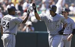 Chicago White Sox's Jose Abreu (79) is congratulated by Dayan Viciedo, left, after Abreu hit a three-run home run off Oakland Athletics' Luke Gregerson in the eighth inning of a baseball game Wednesday, May 14, 2014, in Oakland, Calif. (AP Photo)