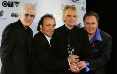 The band Loverboy is inducted into the Canadian Music Hall of Fame in 2009.