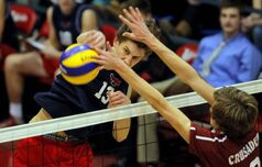 Hawks' Josh Goosen creams the ball as Crusaders' Adam DeJonckheere tries to get a hand on it.