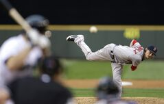 Boston Red Sox starting pitcher Clay Buchholz watches a throw to a Seattle Mariners batter in the fourth inning of a baseball game, Wednesday, June 25, 2014, in Seattle. (AP Photo/Ted S. Warren)