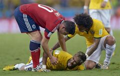Brazil's Neymar screams out after being fouled during the World Cup quarterfinal soccer match between Brazil and Colombia at the Arena Castelao in Fortaleza, Brazil, Friday, July 4, 2014. (AP Photo/Manu Fernandez)