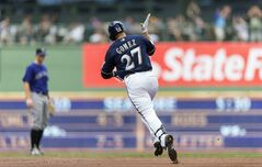 Carlos Gomez of the Milwaukee Brewers rounds the bases after hitting a two run home run off of Jhoulys Chacin of the Colorado Rockies during the first inning of a baseball game Saturday, June 28, 2014, in Milwaukee. (AP Photo/Tom Lynn)