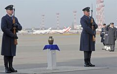Polish Air Force soldiers salute the ashes of Gen.Tadeusz Sawicz, the last surviving Polish pilot from the 1940 Battle of Britain, during the arrival ceremony at the military airport in Warsaw, Poland, Tuesday, Nov. 29, 2011. Sawicz died last month in Toronto, Canada, at the age of 97. (AP Photo/Alik Keplicz)