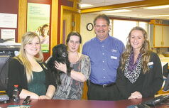 Collin Bell and the staff at One Insurance. Breezy, the director of greetings (DOG) is hard to miss.