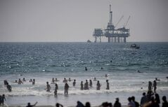 An oil rig looms off Huntington Beach on Aug. 4, 2012. THE CANADIAN PRESS/AP, Grant Hindsley