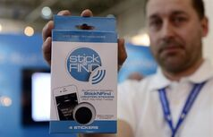 A man holds the Stick-N-Find product at the Mobile World Congress, the world's largest mobile phone trade show, in Barcelona, Spain Wednesday Feb. 27, 2013. (Manu Fernandez / Associated Press archives)