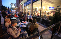 In this file photo, overflow participants watch a political debate from the patio at the Winnipeg Free Press News Cafe.