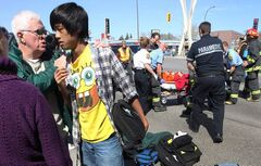 The brother of a boy who was hit by a vehicle at Killarney St and Pembina Highway near 3 p.m. Thursday is comforted by bystanders who witnessed the accident. Several school friends watched as emergency medical crews tended to the boy at the scene.