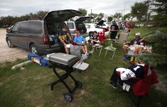 Tailgaters relish the excitement of Thursday's home opener in the parking lot of Investors Group Field.