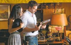 Zoe Saldana and Bradley Cooper check out items they'll need for a good Indiana Jones costume.