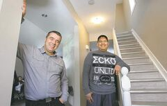 WAYNE GLOWACKI / WINNIPEG FREE PRESS   Inner City Youth Alive's Kent Dueck (left) with Jeremy Soldat, who helped renovate a North End home. Soldat says the project makes him want to rebuild his life.