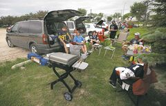 Tailgaters live it up in the parking lot before the Bombers' home opener Thursday evening. And for a change, fans even enjoyed the game.