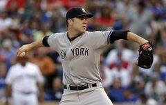 New York Yankees starting pitcher David Phelps works against the Texas Rangers in the third inning of a baseball game, Monday, July 28, 2014, in Arlington, Texas. (AP Photo/Tony Gutierrez)