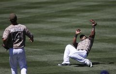 San Diego Padres right fielder Rymer Liriano makes the catch despite battling the sun on a bases loaded pop up hit by Los Angeles Dodgers' Scott Van Slyke in the third inning of a baseball game Sunday, Aug. 31, 2014, in San Diego. (AP Photo/Lenny Ignelzi)
