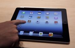 Competition has heated up and consumers now have a dizzying array of tablet options to consider. In this March 7, 2012, file photo, a new Apple iPad is on display during an Apple event in San Francisco. THE CANADIAN PRESS/AP-Paul Sakuma, File