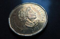 A Canadian dollar or loonie is pictured in North Vancouver on March 5, 2014. THE CANADIAN PRESS/Jonathan Hayward