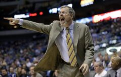 Brooklyn Nets head coach P.J. Carlesimo yells from the sideline during the first half of an NBA basketball game against the Dallas Mavericks Wednesday, March 20, 2013, in Dallas. (AP Photo/LM Otero)